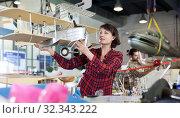 Купить «Happy female holding sports biplane model», фото № 32343222, снято 4 марта 2019 г. (c) Яков Филимонов / Фотобанк Лори
