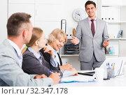 Купить «Chief gathering managers for meeting», фото № 32347178, снято 1 июля 2017 г. (c) Яков Филимонов / Фотобанк Лори