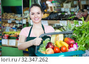 Купить «smiling woman with range of vegetables and fruits in basket», фото № 32347262, снято 14 октября 2017 г. (c) Яков Филимонов / Фотобанк Лори