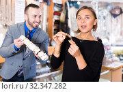 Купить «Portrait of woman customer trying bracelet», фото № 32347282, снято 16 октября 2017 г. (c) Яков Филимонов / Фотобанк Лори