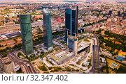 View of four modern business skyscrapers (Cuatro Torres) in Madrid (2019 год). Редакционное фото, фотограф Яков Филимонов / Фотобанк Лори