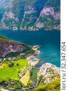 Aurland Village and Aurlandsfjord seen from Stegastein Overlook, The West Norwegian Fjords, Norway. Стоковое фото, фотограф Николай Коржов / Фотобанк Лори