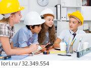 Boys and girls architects with plan. Стоковое фото, фотограф Яков Филимонов / Фотобанк Лори