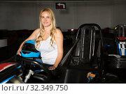 Купить «woman with helmet sitting in car for motor racing», фото № 32349750, снято 30 мая 2020 г. (c) Яков Филимонов / Фотобанк Лори