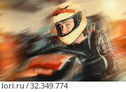 Male in helmet and other people driving cars for karting in spo. Стоковое фото, фотограф Яков Филимонов / Фотобанк Лори