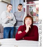 Купить «Chagrined senior woman in quarrel with young couple», фото № 32353162, снято 27 ноября 2017 г. (c) Яков Филимонов / Фотобанк Лори