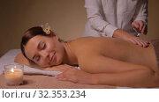 Купить «close up of woman having back massage at spa», видеоролик № 32353234, снято 19 октября 2019 г. (c) Syda Productions / Фотобанк Лори