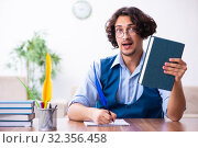 Young writer working on his new work. Стоковое фото, фотограф Elnur / Фотобанк Лори