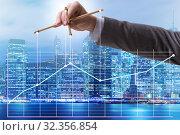 Купить «Businessman controlling the market with strings», фото № 32356854, снято 5 декабря 2019 г. (c) Elnur / Фотобанк Лори
