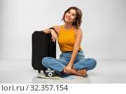 Купить «woman with travel bag, air ticket, map and camera», фото № 32357154, снято 30 сентября 2019 г. (c) Syda Productions / Фотобанк Лори