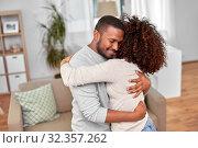 Купить «happy african american couple hugging at home», фото № 32357262, снято 22 сентября 2019 г. (c) Syda Productions / Фотобанк Лори