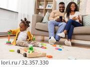 Купить «african baby girl playing with toy blocks at home», фото № 32357330, снято 29 сентября 2019 г. (c) Syda Productions / Фотобанк Лори