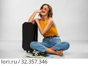 Купить «woman with travel bag, air ticket, map and camera», фото № 32357346, снято 30 сентября 2019 г. (c) Syda Productions / Фотобанк Лори