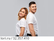 Купить «portrait of happy couple in white t-shirts», фото № 32357410, снято 6 октября 2019 г. (c) Syda Productions / Фотобанк Лори