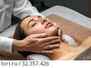 woman having face and head massage at spa. Стоковое фото, фотограф Syda Productions / Фотобанк Лори