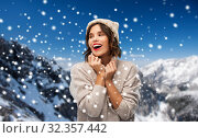 Купить «young woman in knitted winter hat in mountains», фото № 32357442, снято 30 сентября 2019 г. (c) Syda Productions / Фотобанк Лори