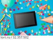 Купить «tablet computer, birthday gift and party props», фото № 32357502, снято 11 декабря 2018 г. (c) Syda Productions / Фотобанк Лори