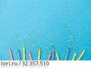 Купить «birthday candles with sprinkles on blue background», фото № 32357510, снято 12 декабря 2018 г. (c) Syda Productions / Фотобанк Лори
