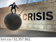 Купить «Businessman in crisis management concept», фото № 32357962, снято 20 февраля 2020 г. (c) Elnur / Фотобанк Лори