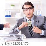 Купить «Businessmanbeing offered bribe for breaking law», фото № 32358170, снято 11 декабря 2017 г. (c) Elnur / Фотобанк Лори