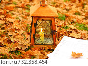Купить «Vintage lantern with notes on yellow leaves in the park», фото № 32358454, снято 29 октября 2019 г. (c) Марина Володько / Фотобанк Лори