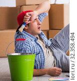 Купить «Young painter contractor choosing colors for home renovation», фото № 32358494, снято 6 октября 2017 г. (c) Elnur / Фотобанк Лори