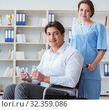 Купить «Disabled patient on wheelchair visiting doctor for regular check», фото № 32359086, снято 12 апреля 2017 г. (c) Elnur / Фотобанк Лори