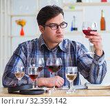Купить «Professional sommelier tasting red wine», фото № 32359142, снято 31 марта 2017 г. (c) Elnur / Фотобанк Лори