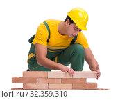 Купить «The handsome construction worker building brick wall», фото № 32359310, снято 5 ноября 2016 г. (c) Elnur / Фотобанк Лори