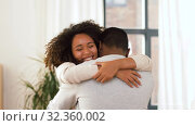 Купить «happy african american couple hugging at home», видеоролик № 32360002, снято 17 октября 2019 г. (c) Syda Productions / Фотобанк Лори