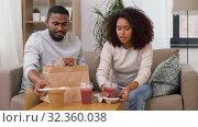 Купить «couple with takeaway food and straw drinks at home», видеоролик № 32360038, снято 17 октября 2019 г. (c) Syda Productions / Фотобанк Лори