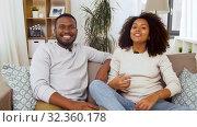 Купить «couple of video bloggers videoblogging at home», видеоролик № 32360178, снято 17 октября 2019 г. (c) Syda Productions / Фотобанк Лори