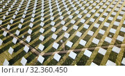 Купить «Aerial view of solar power station installed in green field», видеоролик № 32360450, снято 19 декабря 2018 г. (c) Яков Филимонов / Фотобанк Лори