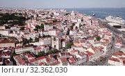 Купить «Aerial view of historical centre of Lisbon overlooking medieval Roman Catholic Cathedral and Castle of Sao Jorge, Portugal», видеоролик № 32362030, снято 20 апреля 2019 г. (c) Яков Филимонов / Фотобанк Лори