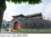Купить «Paldalmun gate is the southern gate of hwaseong fortress located in suwon, South Korea. Taken on July 26 2018», фото № 32364050, снято 26 июля 2018 г. (c) easy Fotostock / Фотобанк Лори