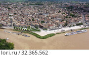 Купить «Panoramic aerial view of Libourne city on Dordogne river on sunny summer day, Gironde, France», видеоролик № 32365562, снято 18 июля 2019 г. (c) Яков Филимонов / Фотобанк Лори