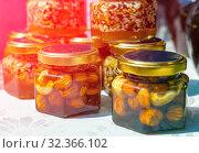 Купить «Goodbee Products. Glass jars: honey with seeds, cream honey with nuts at the gastronomic festival in Samara.», фото № 32366102, снято 27 июля 2019 г. (c) Акиньшин Владимир / Фотобанк Лори
