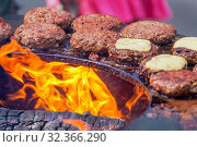 Купить «Cooking street food. The meat is fried over an open fire.», фото № 32366290, снято 27 июля 2019 г. (c) Акиньшин Владимир / Фотобанк Лори
