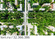 Купить «Aerial city view with crossroads and roads, houses, buildings, parks and parking lots. Sunny summer panoramic image», фото № 32366386, снято 21 января 2020 г. (c) Александр Маркин / Фотобанк Лори