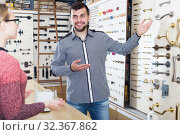 Купить «Young seller helping female client to choose door handles», фото № 32367862, снято 5 апреля 2017 г. (c) Яков Филимонов / Фотобанк Лори