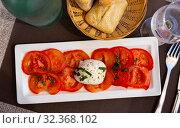 Slices of tomatoes and mozzarella cheese, dish of Italian cuisine. Стоковое фото, фотограф Яков Филимонов / Фотобанк Лори