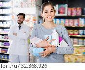 Купить «Smiling female client is satisfied of recommended medicine in apothecary.», фото № 32368926, снято 28 февраля 2018 г. (c) Яков Филимонов / Фотобанк Лори