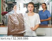 Купить «Displeased client of dry cleaning», фото № 32369086, снято 9 мая 2018 г. (c) Яков Филимонов / Фотобанк Лори