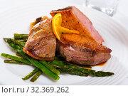 Купить «Roasted duck breast with asparagus closeup», фото № 32369262, снято 18 ноября 2019 г. (c) Яков Филимонов / Фотобанк Лори