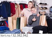 Купить «Satisfied mother and daughter with shopping bags in store», фото № 32382942, снято 21 марта 2018 г. (c) Яков Филимонов / Фотобанк Лори