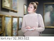 Купить «Portrait of ordinary woman looking at pictures», фото № 32383022, снято 18 ноября 2017 г. (c) Яков Филимонов / Фотобанк Лори