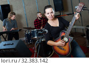 Купить «excited girl rock singer with guitar during rehearsal», фото № 32383142, снято 26 октября 2018 г. (c) Яков Филимонов / Фотобанк Лори