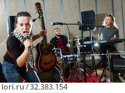 Купить «excited girl rock singer with guitar during rehearsal», фото № 32383154, снято 26 октября 2018 г. (c) Яков Филимонов / Фотобанк Лори