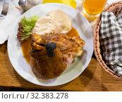 Купить «Pork shank with horseradish, mustard and bread», фото № 32383278, снято 21 ноября 2019 г. (c) Яков Филимонов / Фотобанк Лори