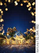 Купить «Christmas gold garland with fir tree on blue glitter. Copy space, frame.», фото № 32384182, снято 5 ноября 2019 г. (c) Евдокимов Максим / Фотобанк Лори